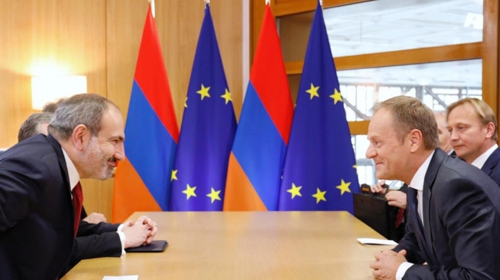 Mr. Pashinyan's eyes light up as he is told of his new salary from Brussels.